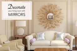 decorative sunburst mirror behind sofa